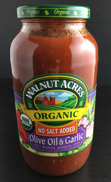 A glass jar of organic tomato sauce for Beefy Tomato Bolognese Sauce
