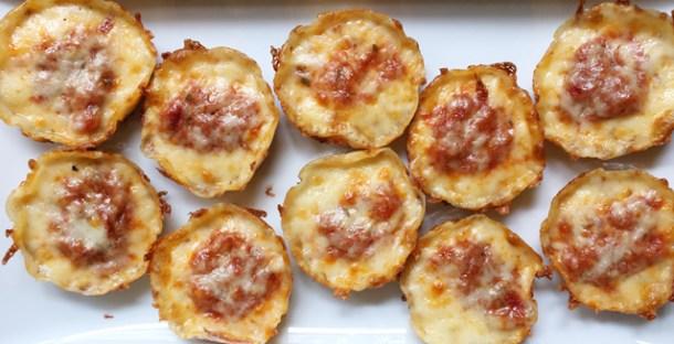 A white platter of 10 Cheesy Cauliflower Pizza Bites