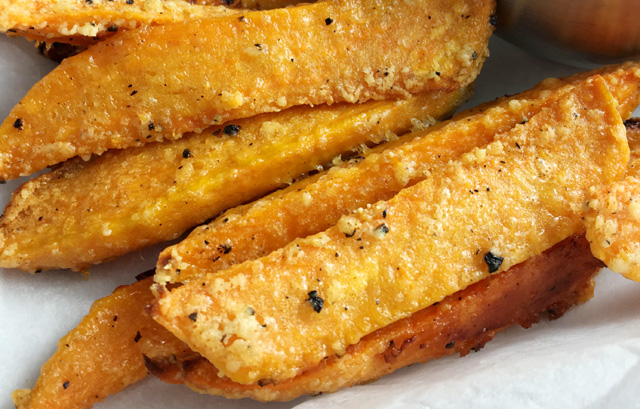 Crispy Sweet Potato Fries speckled withblack pepper