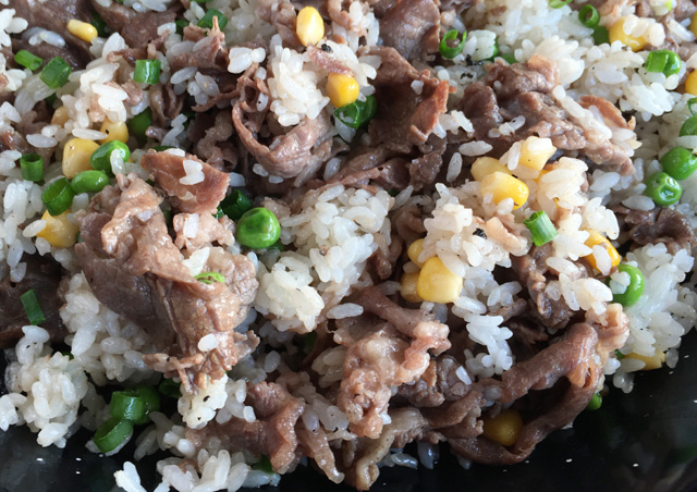 Close-up of Pepper Beef Rice Skillet containing rice, beef, corn, and peas