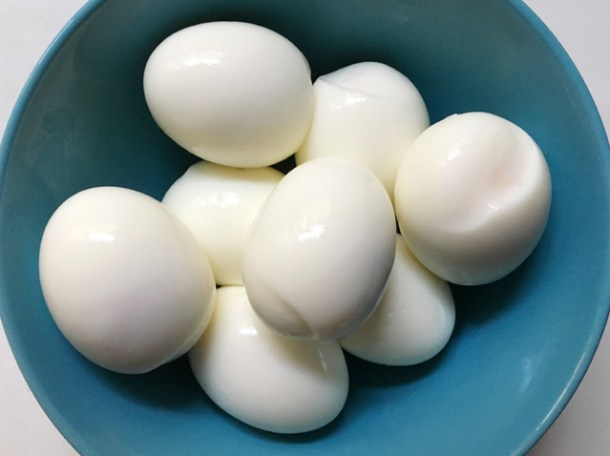 A blue bowl of hard-cooked eggs from Cooking Eggs In A Rice Cooker