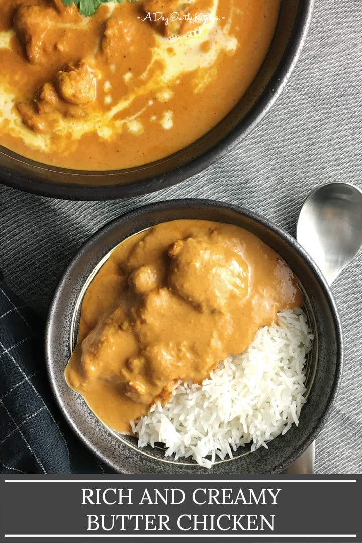 A dark round bowl containing white rice and chicken covered in an orange sauce, the words rich and creamy butter chicken on the bottom