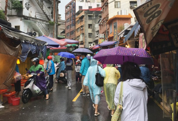 Walking through the wet market in Tamsui in Taipei
