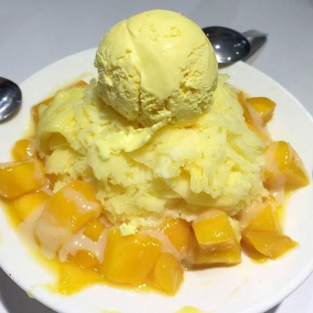 A white bowl containing mango shaved ice, mango ice cream, and fresh mango - eat in Taipei