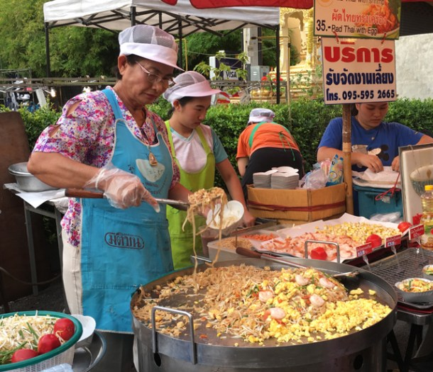 A lady cooking up a large amount of pad Thai at the Saturday Night Market in Chiang Mai