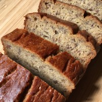 Slices of gluten-free banana bread on a wooden cutting board