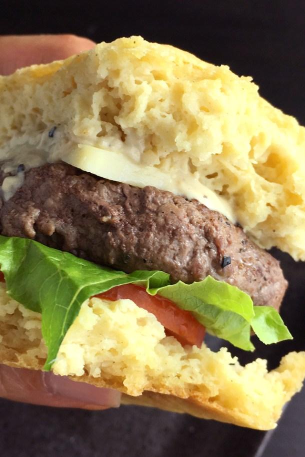 Close-up of a hamburger containing homemade hamburger patty