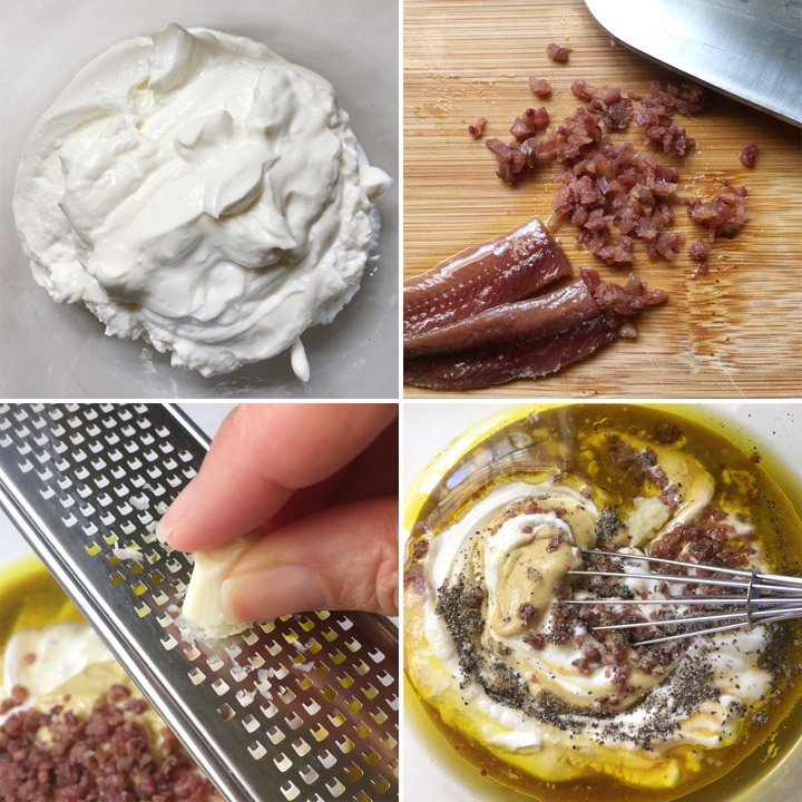 A bowl of white yogurt, minced fish filets on a wood cutting board, a garlic clove being grated using a microplane, a bowl containing white yogurt, oil, pepper, mustard, and a whisk