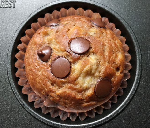 Close-up of a banana chocolate chip muffin in a muffin pan