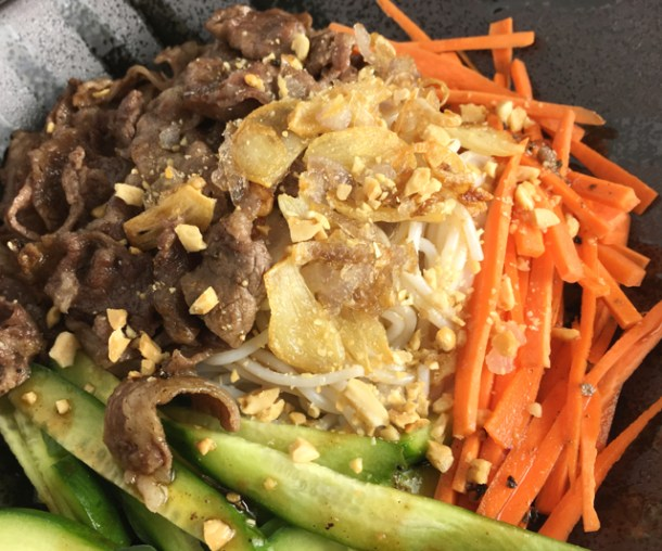 Close-up of Savory Vietnamese Beef Vermicelli in a black bowl