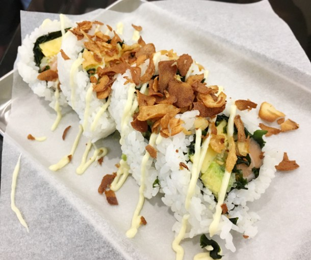A custom roll containing salmon, avocado, tamago and garlic chips from Chotto Maki