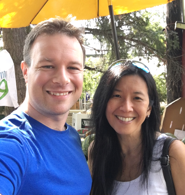 A Caucasian man and an Asian woman, meeting food bloggers