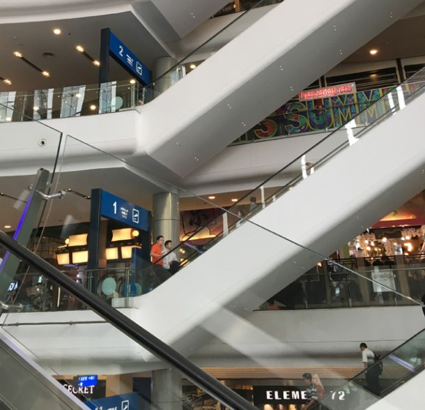 White escalators in a mall