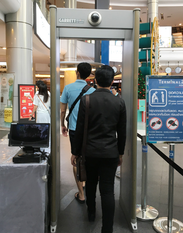 People walking through a metal detector