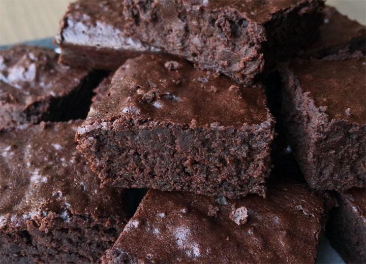 A pile of dark brown chocolate brownie squares