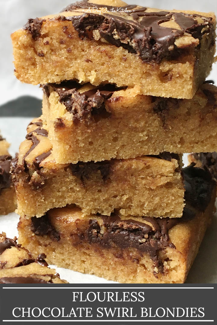 A stack of four baked squares, the words flourless chocolate swirl blondies on the bottom