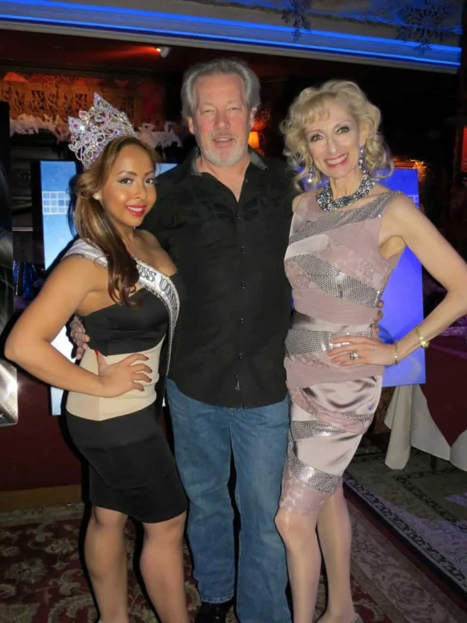 A.D. Cook with beauty queens Tara and Nicole