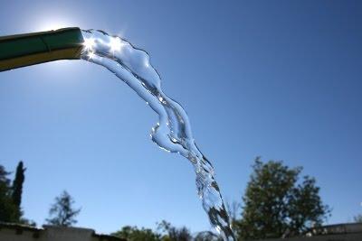 riego manguera agua potable