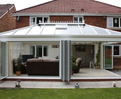 Conservatory with open Bifold Doors