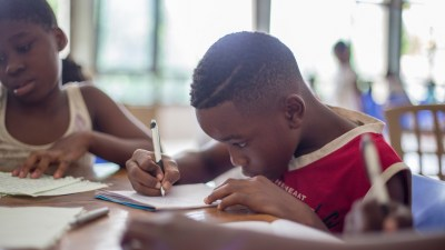 A boy with ADHD works hard at school.