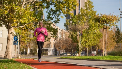A girl running during a break from college classes