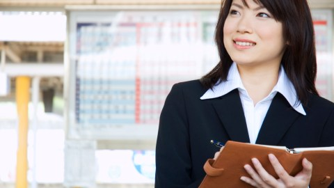 A businesswoman schedules meetings ahead of time to allow her to keep track of everything and plan accordingly, helping her manage her ADHD in the workplace.