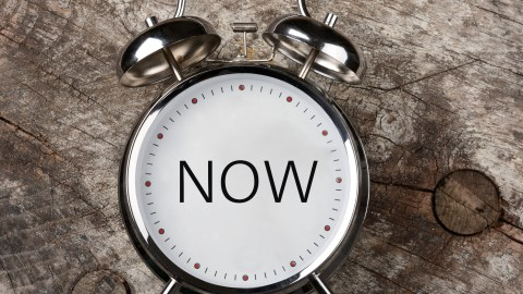 """The dial on a clock says """"now"""" — learning prioritization techniques is an important part of CBT."""