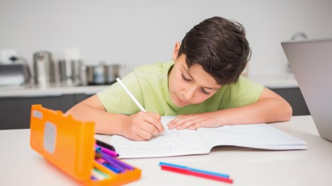 A boy with ADHD practicing writing strategies at home