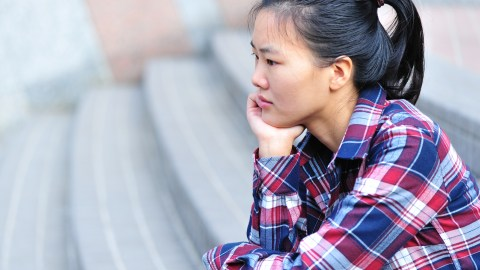 A woman feels depressed, a common ADHD emotion.