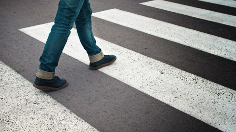 Woman walking — simply keep putting one foot in front of the other.