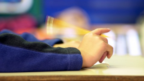 A student fidgeting during a test which 504 accomodations for adhd can help ease and mitigate.
