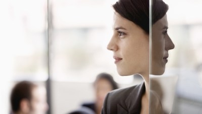 """A woman stands in the doorway to a conference room and wonders, """"Should I tell my boss I have ADD?"""""""