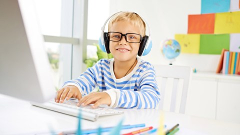 A boy uses music as a fidget to improve him focus and him study.