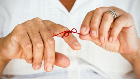 A person with ADHD ties a string around her finger to help her remember.