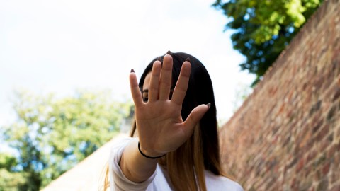 A woman with ADHD and social anxiety covers her face