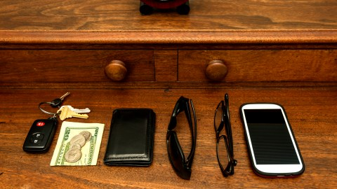 Wallet, phone, sunglasses, etc, all in a row to help a disorganized person feel less overwhelmed