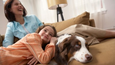 A family laughs together, seeing that ADHD symptoms are better after taking a drug holiday.