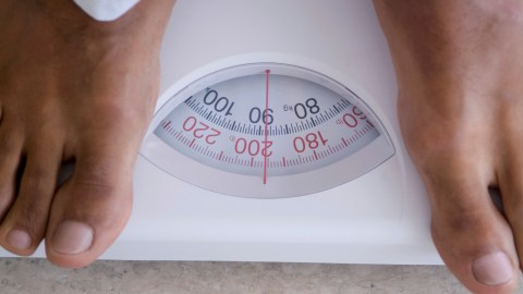 Woman weighing on scale. For some people with adhd, diet and nutrition are key components of managing their symptoms.