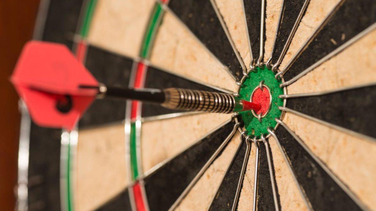 Dart on dartboard thrown by focused ADHD person.
