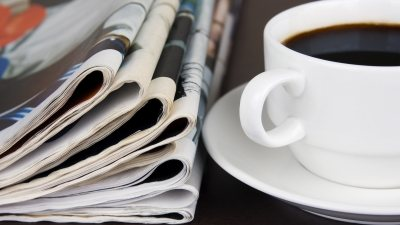 A cup of coffee next to a newspaper on a table makes sleep issues worse for people with ADHD