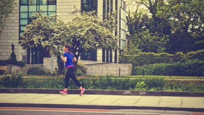 A structured workout can help manage ADHD symptoms, like this woman exercising