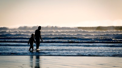 Spending time with your kids is the best way to foster a nurturing environment, like this father with his son on the beach