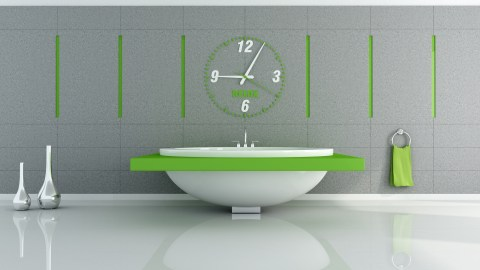 A clock above the bathroom sink, an example of an ADHD organizational tool