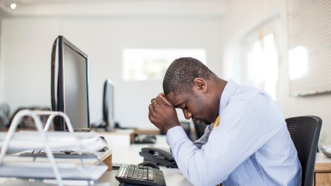 An ADHD man at work struggles with executive function disorder which is common with ADHD
