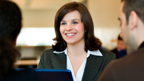 A sales woman with ADHD talks to two prospective clients