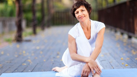 Middle-aged woman with ADHD relaxing after her exercise routine