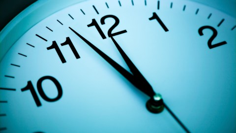 A zoomed in photo of a clock, a tool adults with ADHD can use to stop wasting time