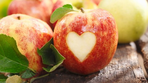 An apple with a heart cutout, a metaphor for how good it feels to stick to ADHD weight loss goals