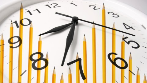 A clock with pencils on it, representing the frustration many children feel during homework time