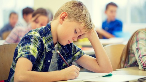 A student with ADHD taking a test to improve his education